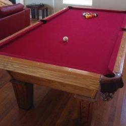 8' Olhausen Pool Table...Red felt...good condition...balls, cues, and rack included.